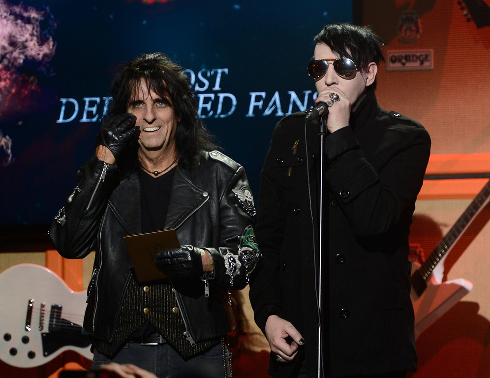 . Musicians Alice Cooper and Marilyn Manson on stage at the 5th Annual Revolver Golden Gods Award Show  at Club Nokia on May 2, 2013 in Los Angeles, California.  (Photo by Frazer Harrison/Getty Images)