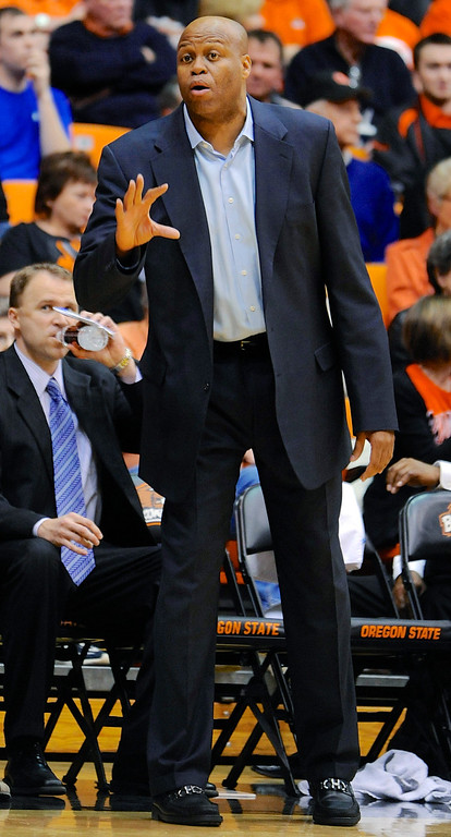 . Oregon State head coach Craig Robinson directs his players against Colorado during the second half of an NCAA college basketball game in Corvallis, Ore., Sunday, Feb. 10, 2013. Colorado won 72-68. (AP Photo/Greg Wahl-Stephens)