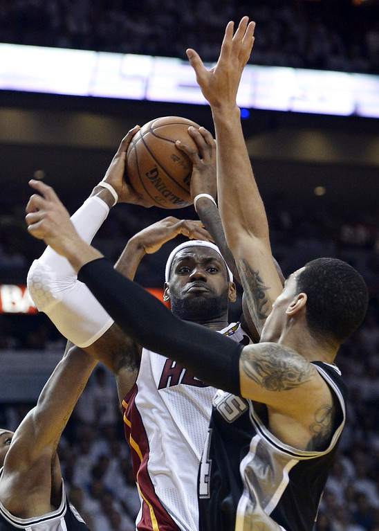 . LeBron James (C) of the Miami Heat shoots against Dann Green (R) of the San Antonio Spurs during the first half in Game 7 of the NBA Finals at the American Airlines Arena June 20, 2013 in Miami, Florida.       BRENDAN SMIALOWSKI/AFP/Getty Images