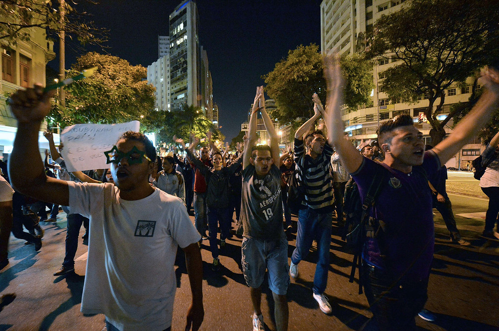 . Demonstrators protest in Belo Horizonte, Brazil on June 21, 2013, against higher public transportation fares and the use of public funds to disrupt international football tournaments.  AFP PHOTO / NELSON  ALMEIDA/AFP/Getty Images