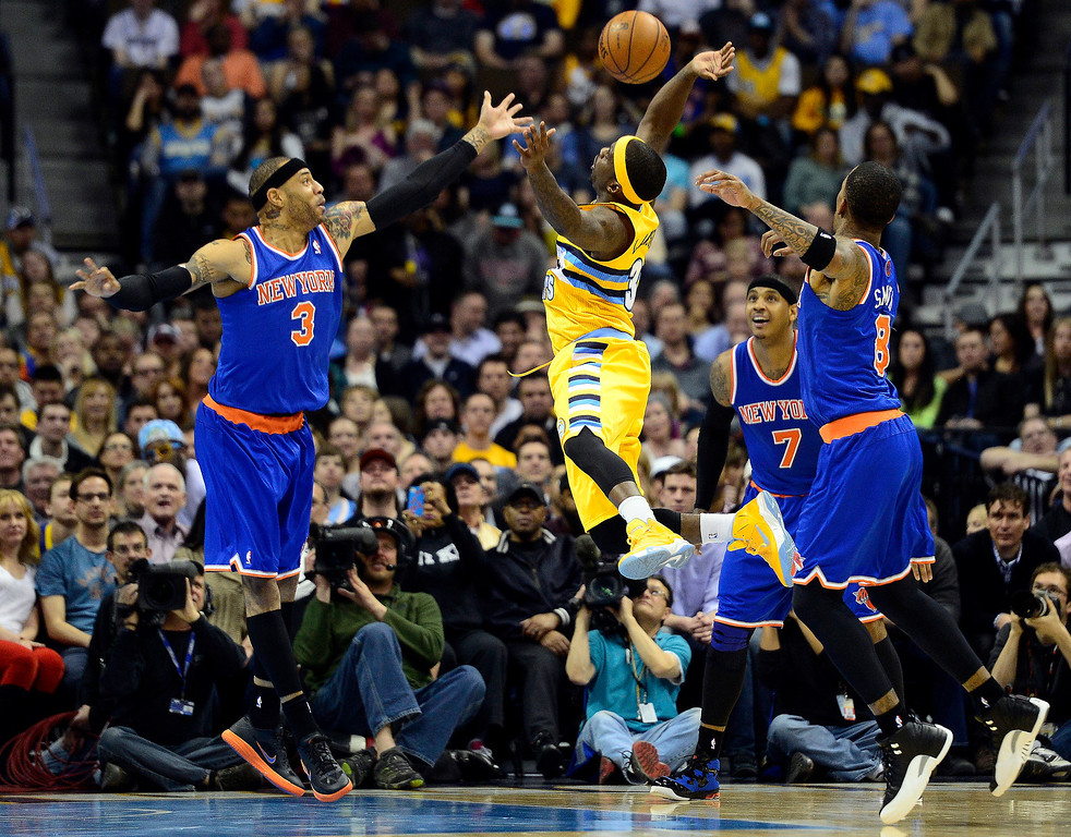 . DENVER, CO - MARCH 13: Kenyon Martin (3) of the New York Knicks with teammates Carmelo Anthony and J.R. Smith (8) of the New York Knicks defend Ty Lawson (3) of the Denver Nuggets during the first half of action. The Denver Nuggets play the New York Knicks at the Pepsi Center. (Photo by AAron Ontiveroz/The Denver Post)