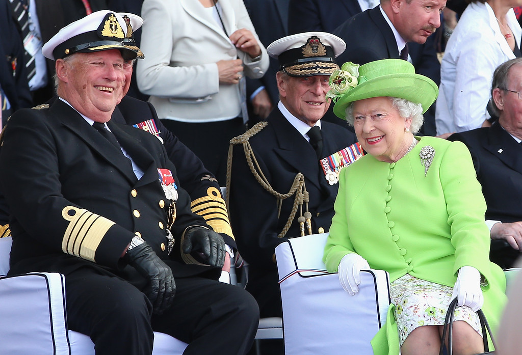 . Queen Elizabeth II shares a joke with King Harald of Norway as she watches a Ceremony to Commemorate D-Day 70 on Sword Beach on June 6, 2014 in Ouistreham, France.  (Photo by Chris Jackson/Getty Images)