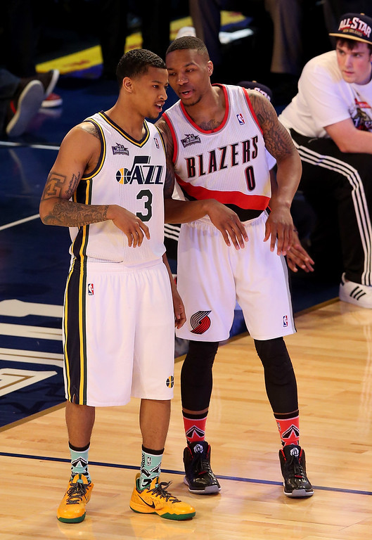 . NEW ORLEANS, LA - FEBRUARY 15:  Western Conference All-Star Trey Burke #3 of the Utah Jazz and Damian Lillard #0 of the Portland Trail Blazers talk during the Taco Bell Skills Challenge 2014 as part of the 2014 NBA All-Star Weekend at the Smoothie King Center on February 15, 2014 in New Orleans, Louisiana. (Photo by Christian Petersen/Getty Images)