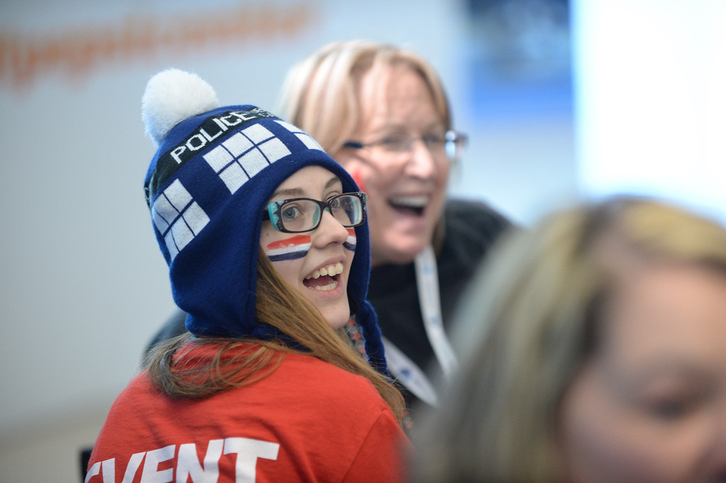. Amber Miller laughs while doing some face painting before the game.   (Photo by Karl Gehring/The Denver Post)