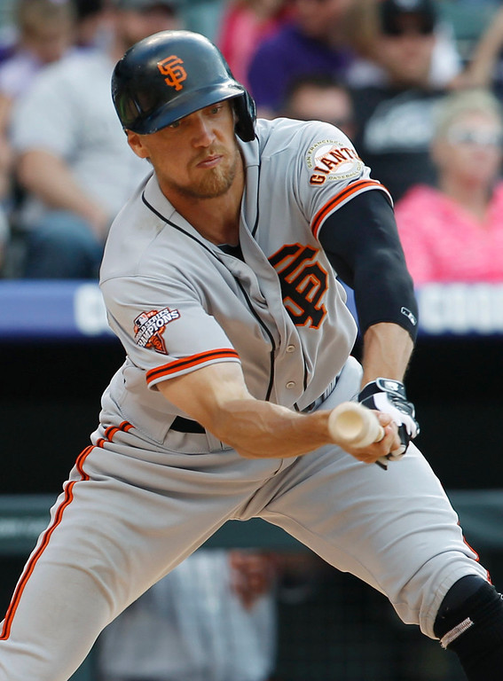 . San Francisco Giants\' Hunter Pence tries to check his swing but is called out on strikes against the Colorado Rockies to lead off the ninth inning of the Rockies\' 5-0 victory in a baseball game in Denver on Sunday, May 19, 2013. (AP Photo/David Zalubowski)