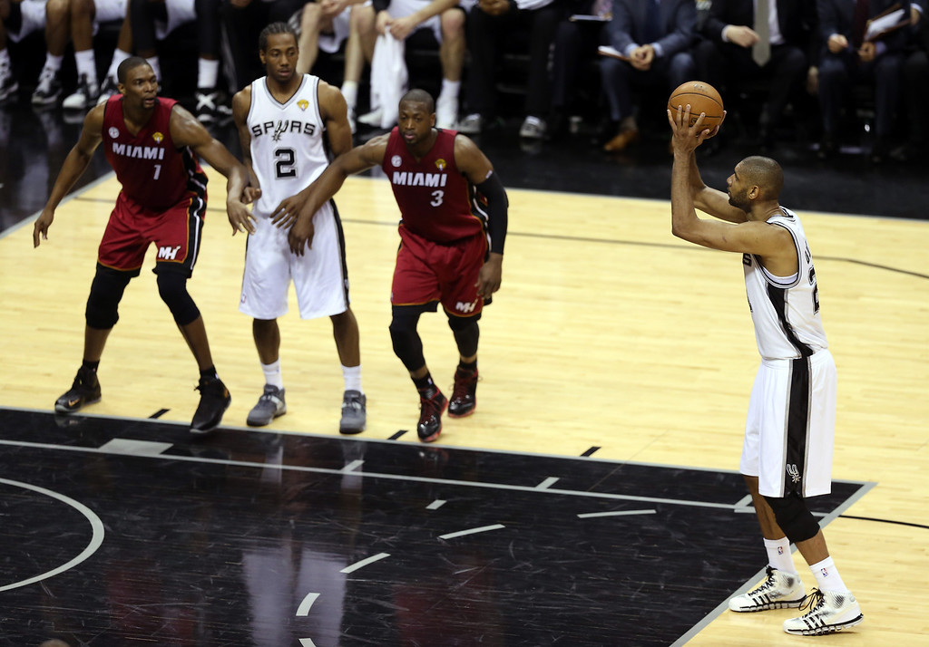 . Tim Duncan #21 of the San Antonio Spurs shoots a free throw in the second quarter while taking on the Miami Heat during Game Three of the 2013 NBA Finals at the AT&T Center on June 11, 2013 in San Antonio, Texas.   (Photo by Christian Petersen/Getty Images)