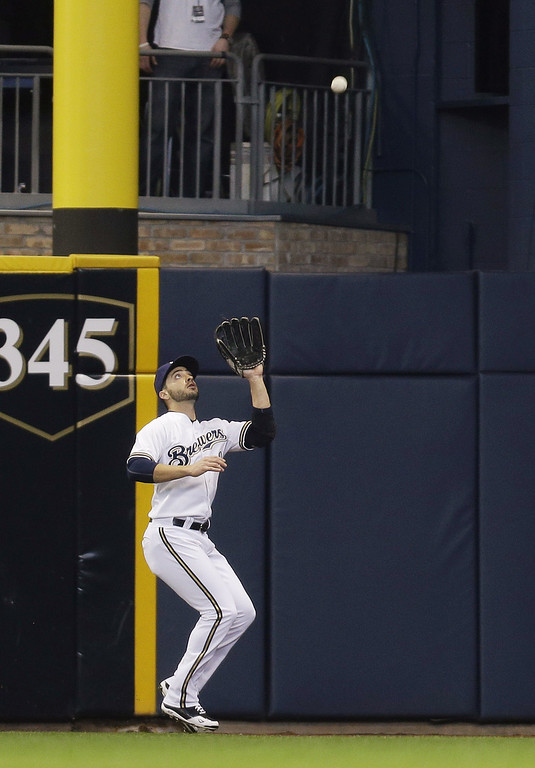 . Ryan Braun #8 of the Milwaukee Brewers makes the catch in right field to retire Dan Uggla of the Atlanta Braves in the top of the second inning during Opening Day at Miller Park on March 31, 2014 in Milwaukee, Wisconsin. (Photo by Mike McGinnis/Getty Images)