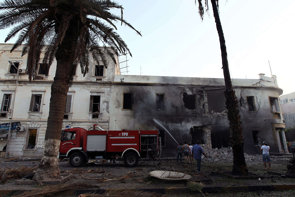 . Libyan firefighters battle to extinguish a fire caused by a powerful blast near a foreign ministry building on September 11, 2013 in the eastern Libyan city of Benghazi. The explosion comes on the first anniversary of an attack by militants on the United States consulate in Benghazi, which killed four Americans, including the ambassador. ABDULLAH DOMA/AFP/Getty Images