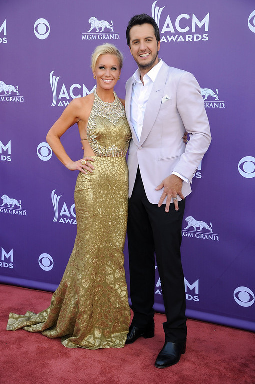 . Singer Luke Bryan, right, and Caroline Bryan arrive at the 48th Annual Academy of Country Music Awards at the MGM Grand Garden Arena in Las Vegas on Sunday, April 7, 2013. (Photo by Al Powers/Invision/AP)