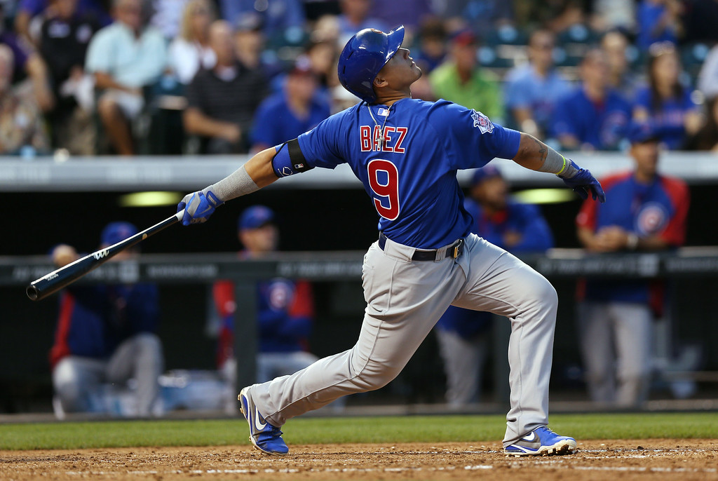 . Chicago Cubs\' Javier Baez flies out against the Colorado Rockies in the fifth inning of the Rockies\' 13-4 victory in a baseball game in Denver on Wednesday, Aug. 6, 2014. (AP Photo/David Zalubowski)