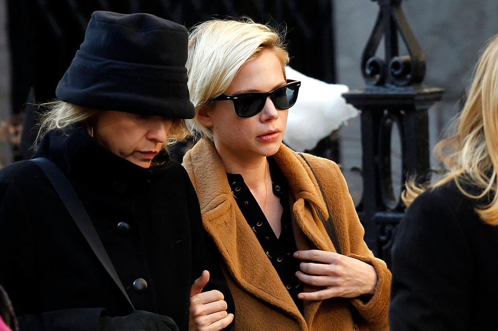 . Actress Michelle Williams, right, arrives at the Church of St. Ignatius Loyola for the private funeral of actor Philip Seymour Hoffman Friday, Feb. 7, 2014, in New York. Hoffman, 46, was found dead Sunday of an apparent heroin overdose. (AP Photo/Jason DeCrow)