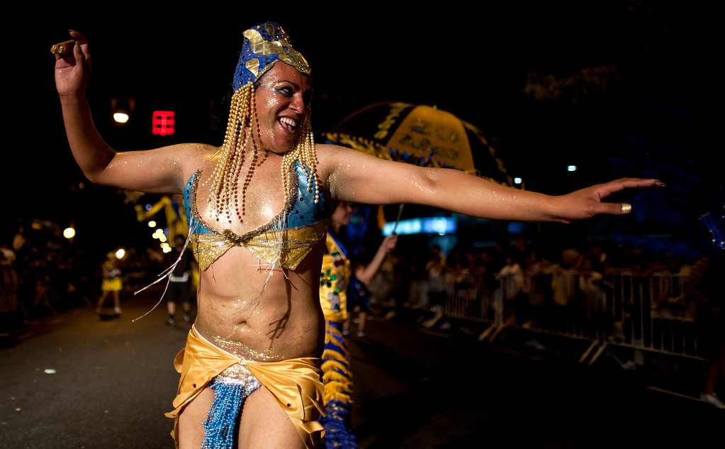 ". A member of the murga ""Los amantes de La Boca\"" performs during carnival celebrations in Buenos Aires, Argentina, Saturday, Feb. 2, 2013. (AP Photo/Natacha Pisarenko)"