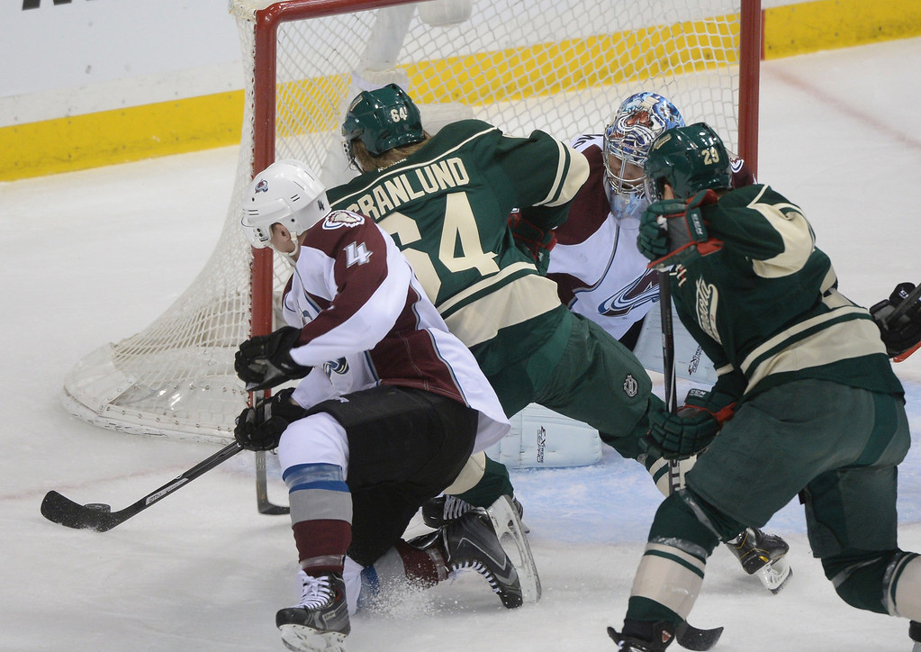 . Minnesota center Mikael Granlund (64) pressured Colorado goaltender Semyon Varlamov (1) in the first period. The Minnesota Wild hosted the Colorado Avalanche at the Xcel Energy Center in St. Paul Monday night, April 21, 2014. (Photo by Karl Gehring/The Denver Post)