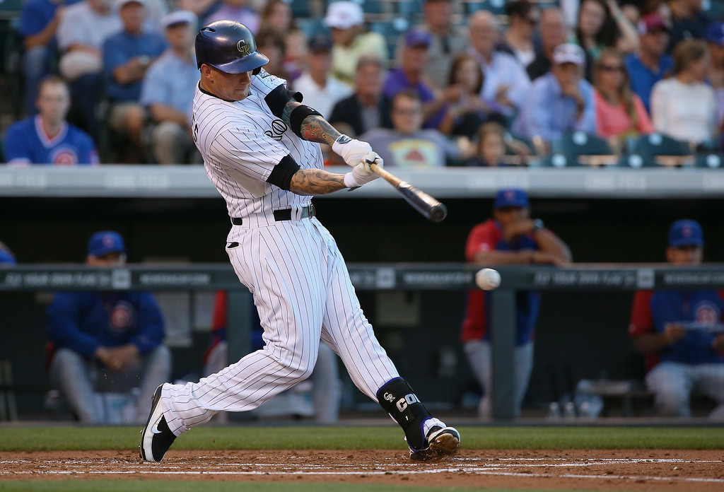 . DENVER, CO - AUGUST 05:  Brandon Barnes #1 of the Colorado Rockies hits a two RBI double off of Travis Wood #37 of the Chicago Cubs to give the Rockies a 2-0 lead in the second inning at Coors Field on August 5, 2014 in Denver, Colorado.  (Photo by Doug Pensinger/Getty Images)
