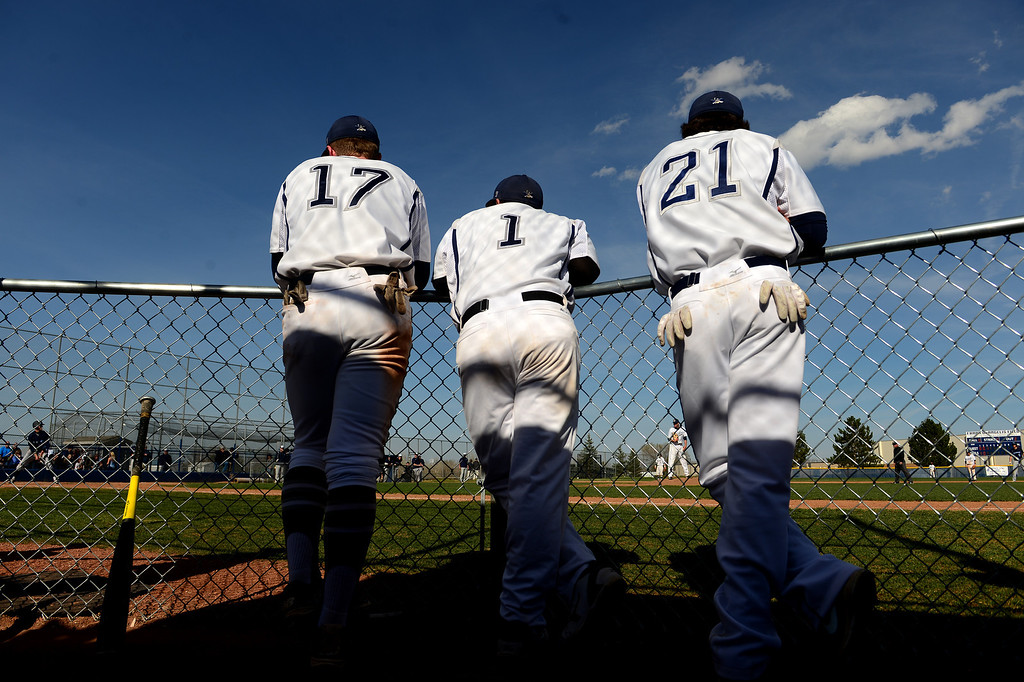 . LITTLETON, CO - APRIL 16,  2014:  Columbine Rebels\' teammates from left to right Cody Wood, #17, Adrian Trujillo, #1 and Tanner Degutis, #21, watch as pitcher Blake Weiman pitches during their game against  the Ralston Valley Mustangs at Columbine High School in Littleton, Co on April 17, 2014. Columbine pitcher Blake Weiman had a great game and was taken out in the fifth inning when the Rebels were up 8 to 1 over the Mustangs. (Photo By Helen H. Richardson/ The Denver Post)