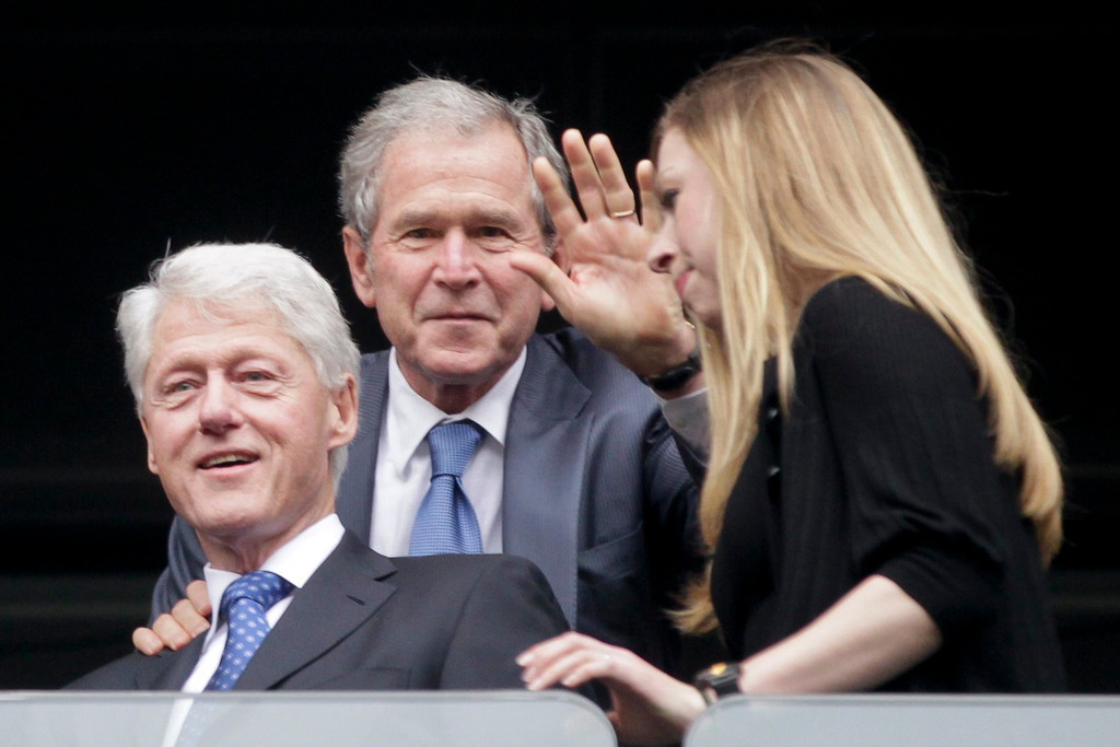 . Former US presidents Bill Clinton (L), George W. Bush (C) and Clinton\'s daughter Chelsea Clinton (R) attend the official memorial ceremony for late South African president Nelson Mandela at FNB Stadium in Johannesburg, South Africa, 10 December 2013. Nobel Peace Prize winner Nelson Mandela died on 05 December at the age of 95.  EPA/DAI KUROKAWA