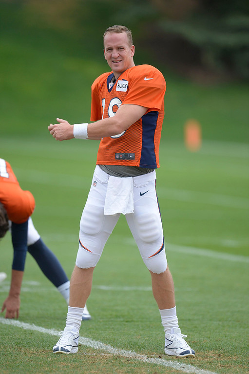 . Denver Broncos quarterback Peyton Manning (18) stretches before practice September 1, 2013 at Dove Valley. (Photo by John Leyba/The Denver Post)