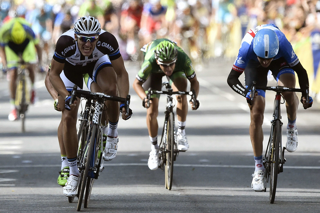 . Germany\'s Marcel Kittel (L) sprints to win ahead of Slovakia\'s Peter Sagan (hidden), Lithuania\'s Ramunas Navardauskas (R), and France\'s Bryan Coquard (C) at the end of the 190.5 km first stage of the 101st edition of the Tour de France cycling race on July 5, 2014 between Leeds and Harrogate, northern England.  The 2014 Tour de France gets underway on July 5 in the streets of Leeds and ends on July 27 down the Champs-Elysees in Paris.  LIONEL BONAVENTURE/AFP/Getty Images