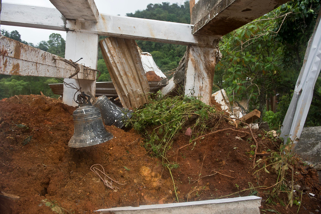 . The remains of the tower of the church can be seen after a landslide in La Pintada, state of Guerrero, Mexico, on September 19, 2013 as heavy rains hit the country.   AFP PHOTO/RONALDO  Schemidt/AFP/Getty Images