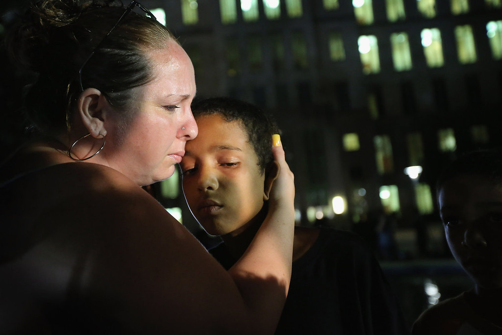 . Melinda O\'Neal (L) breaks into tears and hugs Shedrick Burfect in front of the Seminole County Criminal Justice Center after learning George Zimmerman had been found not guilty in the Murder of Trayvon Martin on July 13, 2013 in Sanford, Florida. Zimmerman, a neighborhood watch volunteer, shot and killed 17-year-old Martin after an altercation in February 2012.  (Photo by Scott Olson/Getty Images)