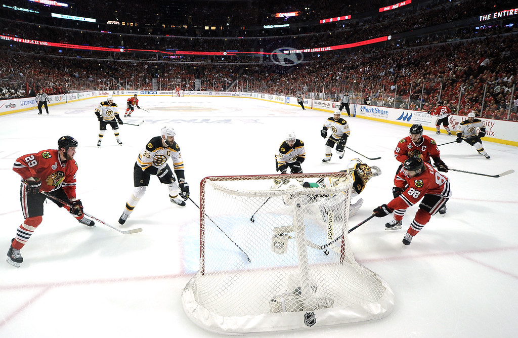 . CHICAGO, IL - JUNE 22:  Patrick Kane #88 of the Chicago Blackhawks scored a goal in the first period against Tuukka Rask #40 of the Boston Bruins in Game Five of the 2013 NHL Stanley Cup Final at United Center on June 22, 2013 in Chicago, Illinois.  (Photo by HH/Getty Images)