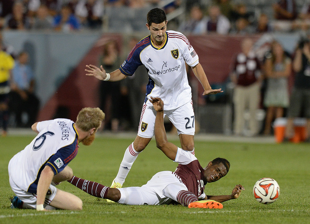 . COMMERCE CITY, CO - AUGUST 2: Colorado forward Deshorn Brown (26) tried to pass the ball to a teammate after was brought down in the second half. Real Salt Lake defeated the Colorado Rapids 1-0 at Dick\'s Sporting Goods Park Saturday night, August 2, 2014.  Photo by Karl Gehring/The Denver Post