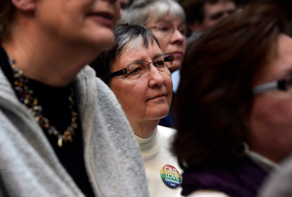. DENVER, CO. - MARCH 21: Kathy McVicker joins the crowd at the History Colorado Center to see Gov. John Hickenlooper sign the Colorado Civil Union Act in  Denver, CO March 21, 2013.   The bill was sponsored by four openly gay lawmakers, Senators Pat Steadman and Lucia Guzman, Representative Sue Schafer, and Speaker Mark Ferrandino. Colorado is one of 18 states that offer recognition of same-sex couples, either through marriage or civil unions, according to the state\'s largest gay-rights group, One Colorado. (Photo By Craig F. Walker/The Denver Post)
