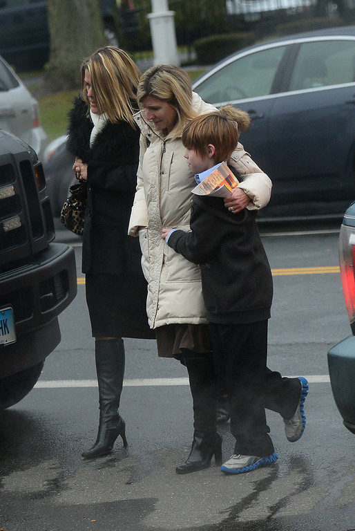 . Mourners leave from Honan funeral home after attending the funeral for Jack Pinto, 6, one of the victims of the Sandy Hook elementary school shooting, on December 17, 2012, in Newtown, Connecticut. Funerals began in the little Connecticut town of Newtown after the school massacre that took the lives of 20 small children and six staff, triggering new momentum for a change to America\'s gun culture. AFP PHOTO/Emmanuel DUNAND/AFP/Getty Images