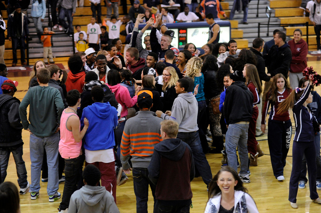 . Cougars students stormed the court after the last second game-winning shot. The Cherokee Trail boy\'s basketball team defeated Overland 59-57 Friday night, January 11, 2013. Karl Gehring/The Denver Post