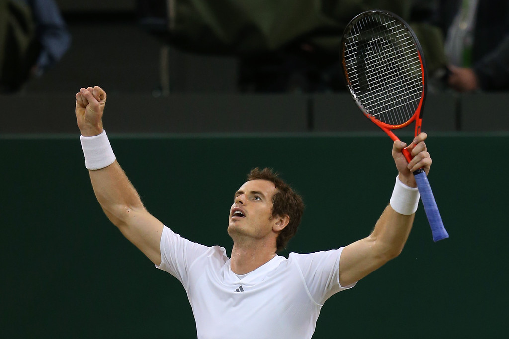 . LONDON, ENGLAND - JULY 05:  Andy Murray of Great Britain celebrates victory during the Gentlemen\'s Singles semi-final match against Jerzy Janowicz of Poland on day eleven of the Wimbledon Lawn Tennis Championships at the All England Lawn Tennis and Croquet Club on July 5, 2013 in London, England.  (Photo by Julian Finney/Getty Images)