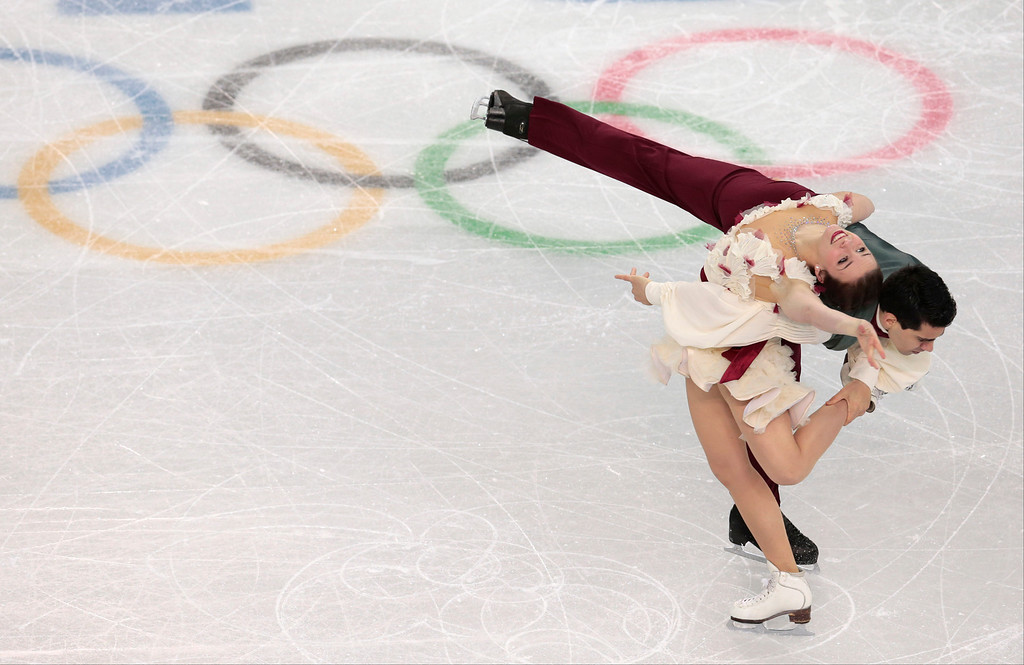 . Anna Cappellini and Luca Lanotte of Italy compete in the ice dance free dance figure skating finals at the Iceberg Skating Palace during the 2014 Winter Olympics, Monday, Feb. 17, 2014, in Sochi, Russia. (AP Photo/Ivan Sekretarev)