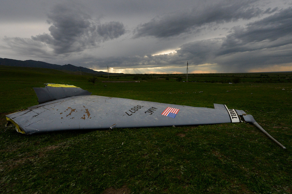 . Wreckage from a U.S. Air Force KC-135 tanker aircraft is strewn across a field near the village of Chaldovar, about 100 miles (160 kms) west of the Kyrgyz capital Bishkek, Friday, May 3, 2013.(AP Photo/Vladimir Voronin)