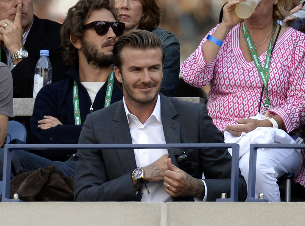. Former soccer player David Beckham of Britain watches Novak Djokovic of Serbia play Rafael Nadal of Spain in the 2013 US Open men\'s singles final  match at the USTA Billie Jean King National Tennis Center in New York on September 9, 2013.   TIMOTHY CLARY/AFP/Getty Images