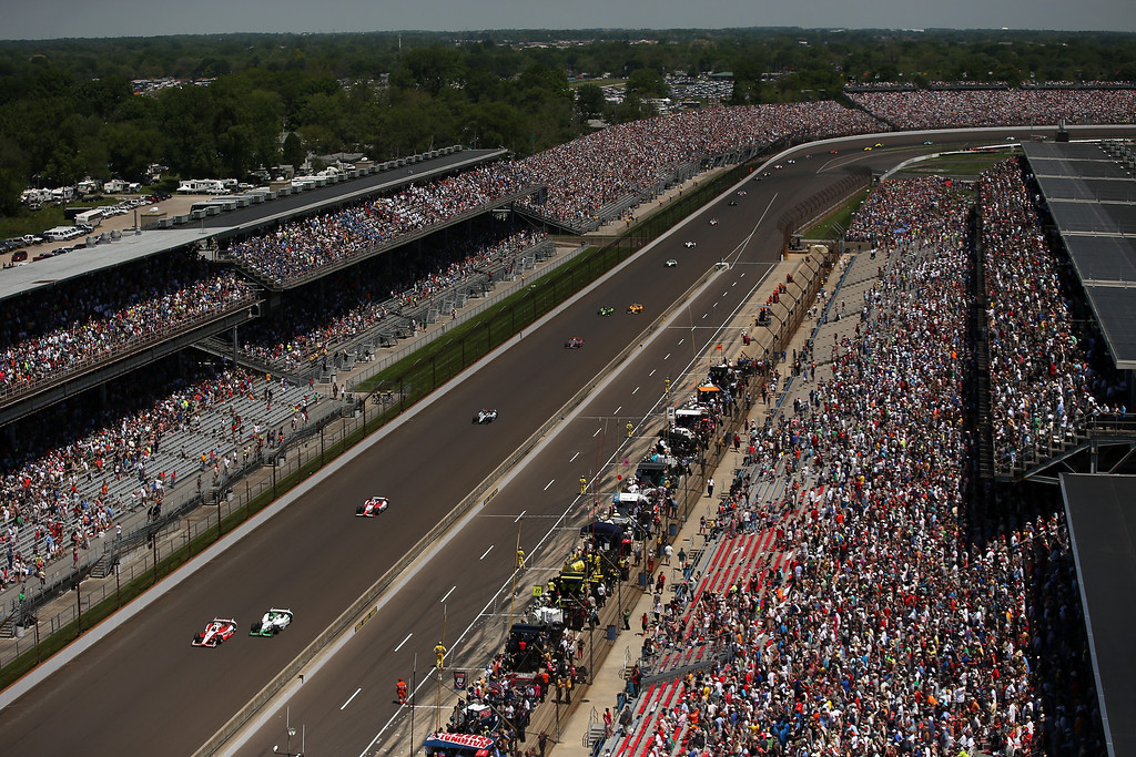 . Cars race along the front stretch during the 98th running of the Indianapolis 500 Mile Race at Indianapolis Motorspeedway on May 25, 2014 in Indianapolis, Indiana.  (Photo by Chris Graythen/Getty Images)