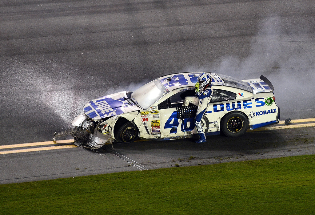 . Jimmie Johnson, driver of the #48 Lowe\'s Chevrolet, climbs from his car after an incident on the last lap of the NASCAR Sprint Cup Series Budweiser Duel 2 at Daytona International Speedway on February 20, 2014 in Daytona Beach, Florida.  (Photo by Jared C. Tilton/Getty Images)