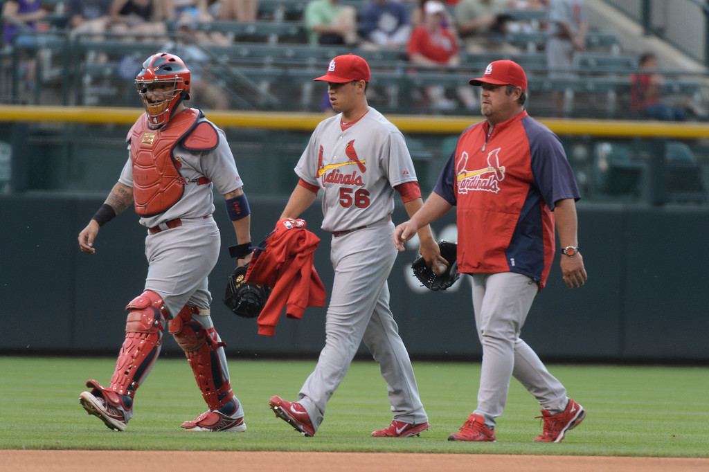 . St. Louis Cardinals starting pitcher Marco Gonzales (56) walks to the dugout after his pre game warmup June 25, 2014 at Coors Field. Gonzales made his MLB debut against the Colorado Rockies. (Photo by John Leyba/The Denver Post)