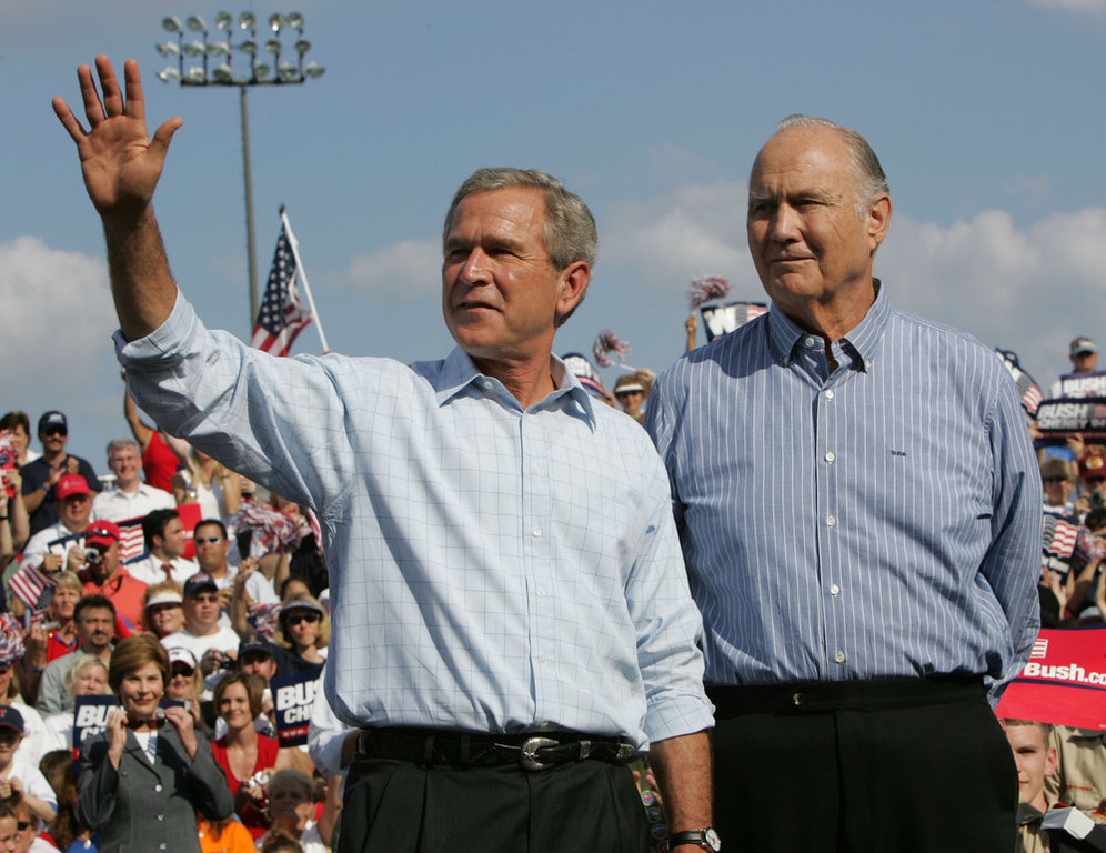 . President Bush, left, is introduced by retired Gen. Norman Schwarzkopf,  commander of Operation Desert Storm, right, during a campaign rally at Legends Field, Sunday, Oct. 31, 2004, in Tampa, Fla. (AP Photo/Pablo Martinez Monsivais)