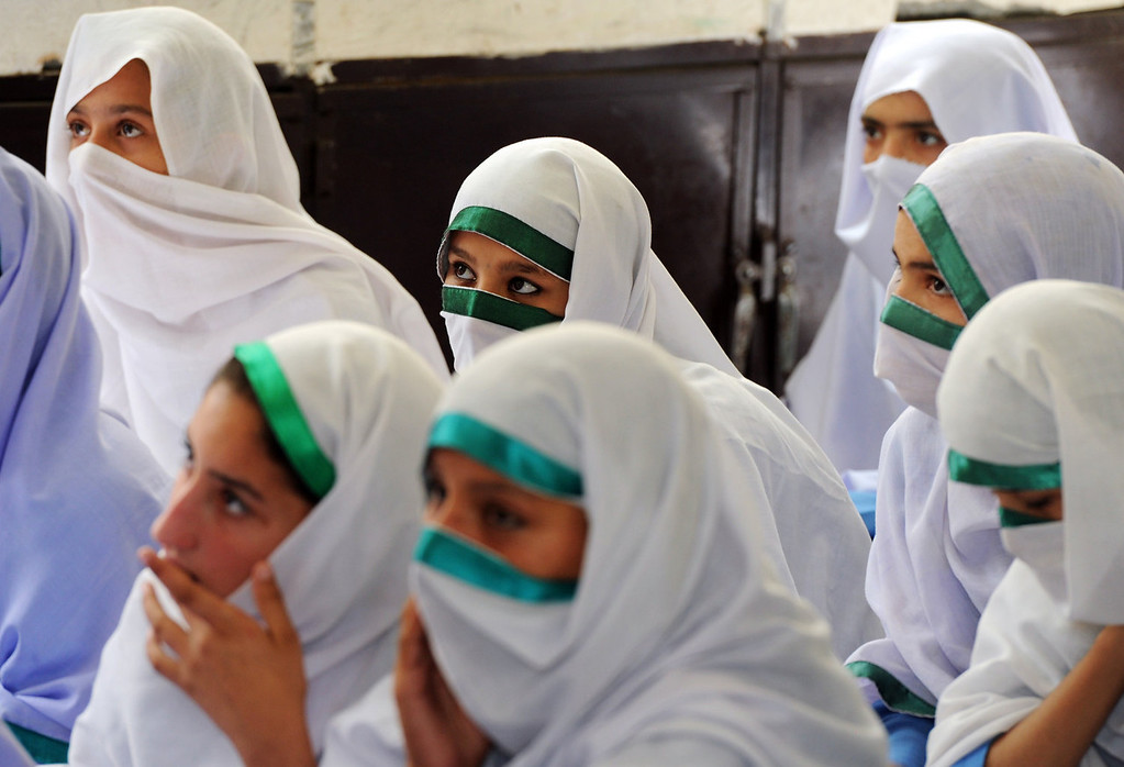 . Pakistani girls attend a class at a school in Mingora, the capital of Swat Valley on September 24, 2013. In Malala Yousafzai\'s home town in Pakistan, school friends hope to see her win the Nobel Peace Prize this week -- but they dream in secret, under pressure from a society deeply ambivalent about the teenage activist.  Malala, who survived being shot by the Taliban on October 9 last year, has become a global ambassador for education, feted by celebrities and politicians around the Western world.   AAMIR QURESHI/AFP/Getty Images