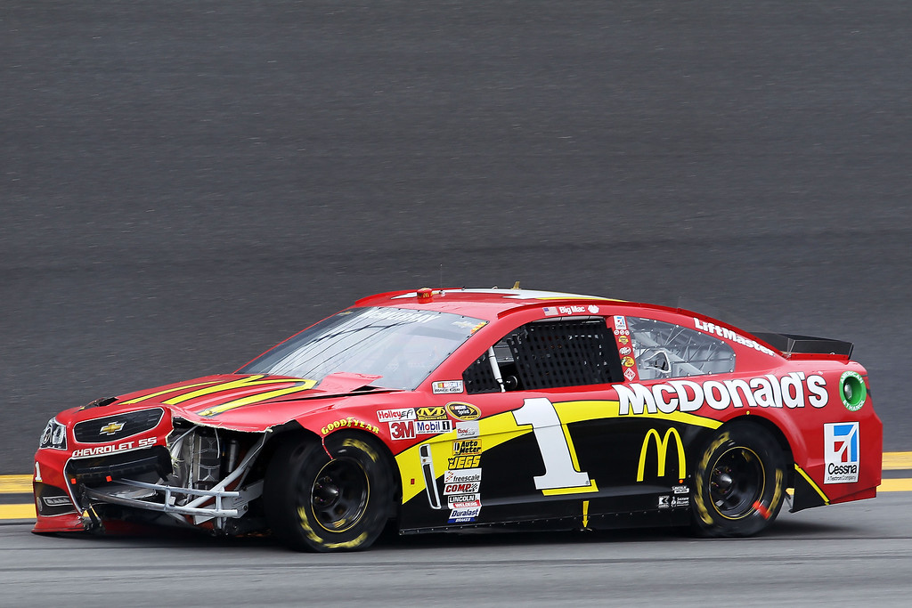 . Jamie McMurray, driver of the #1 McDonald\'s Chevrolet, skids out after an incident during the NASCAR Sprint Cup Series Daytona 500 at Daytona International Speedway on February 24, 2013 in Daytona Beach, Florida.  (Photo by Todd Warshaw/Getty Images)