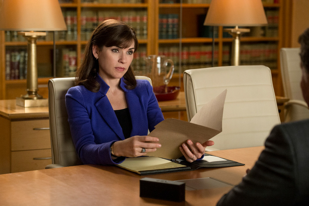 ". This image released by CBS shows Julianna Margulies as Alicia Florrick in a scene from ""The Good Wife.\"" Margulies was nominated for an Emmy Award for best actress in a drama series on, Thursday July 10, 2014. The 66th Primetime Emmy Awards will be presented Aug. 25 at the Nokia Theatre in Los Angeles. (AP Photo/CBS, David Giesbrecht)"