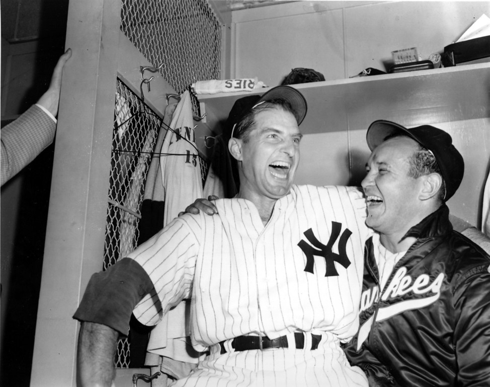 . Tommy Henrich, left, New York Yankees first baseman, and pitcher Allie Reynolds share the role of hero in the Yankees dressing room at Yankee Stadium in New York City on Oct. 5, 1949.  The Yankees defeated the Brooklyn Dodgers in the first game of the 1949 World Series.  Reynolds pitched a two-hit, shout-out ball game against the Dodgers, while Henrich delivered a ninth inning homerun that gave the Yankees a 1-0 win.  (AP Photo/Tom Fitzsimmons)