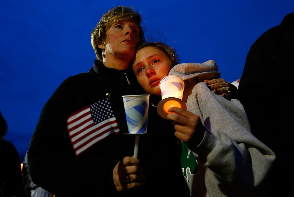 . BOSTON, MA - APRIL 16: A young girl cries with her mother during the vigil for eight-year-old Martin Richard, from Dorchester, who was killed by an explosion near the finish line of the Boston Marathon on April 16, 2013 at Garvey Park in Boston, Massachusetts. The twin bombings resulted in the deaths of three people and hospitalized at least 128. The bombings at the 116-year-old Boston race resulted in heightened security across the nation with cancellations of many professional sporting events as authorities search for a motive to the violence. (Photo by Jared Wickerham/Getty Images)