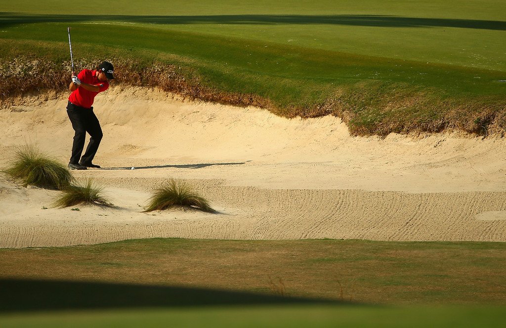 . Erik Compton of the United States hits a shot from a bunker on the ninth hole during the final round of the 114th U.S. Open at Pinehurst Resort & Country Club, Course No. 2 on June 15, 2014 in Pinehurst, North Carolina.  (Photo by Streeter Lecka/Getty Images)