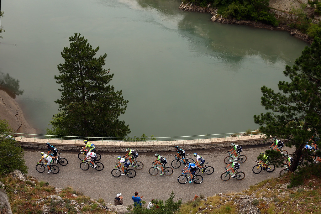 . The peloton pass through Sisteron during the fifteenth stage of the 2014 Tour de France, a 222km stage between Tallard and Nimes, on July 20, 2014 in Sisteron, France.  (Photo by Bryn Lennon/Getty Images)