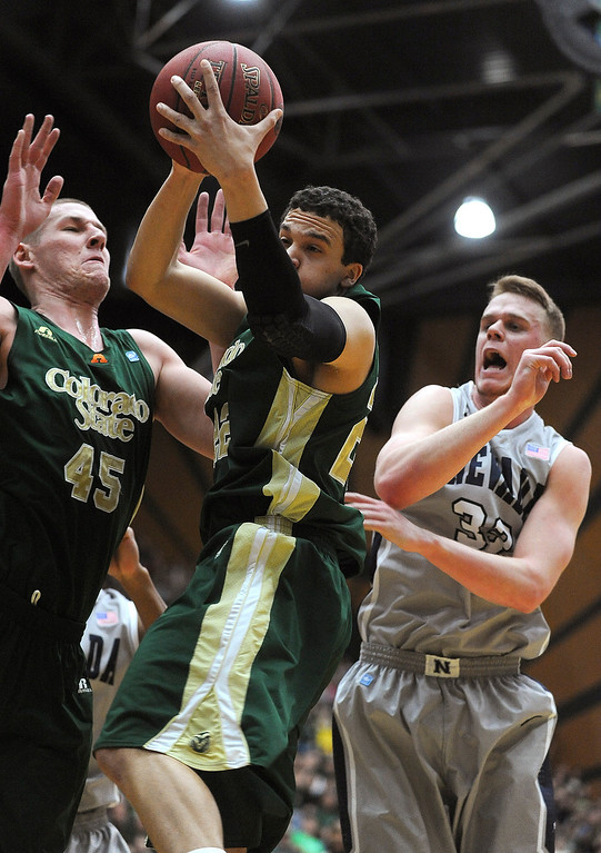 . Colorado State\'s Dorian Green, center, grabs the rebound before Nevada\'s Kevin Panzer during the first half of an NCAA college basketball game in Fort Collins, Colo., Saturday, March 9, 2013. (AP Photo/Fort Collins Coloradoan, Dawn Madura)