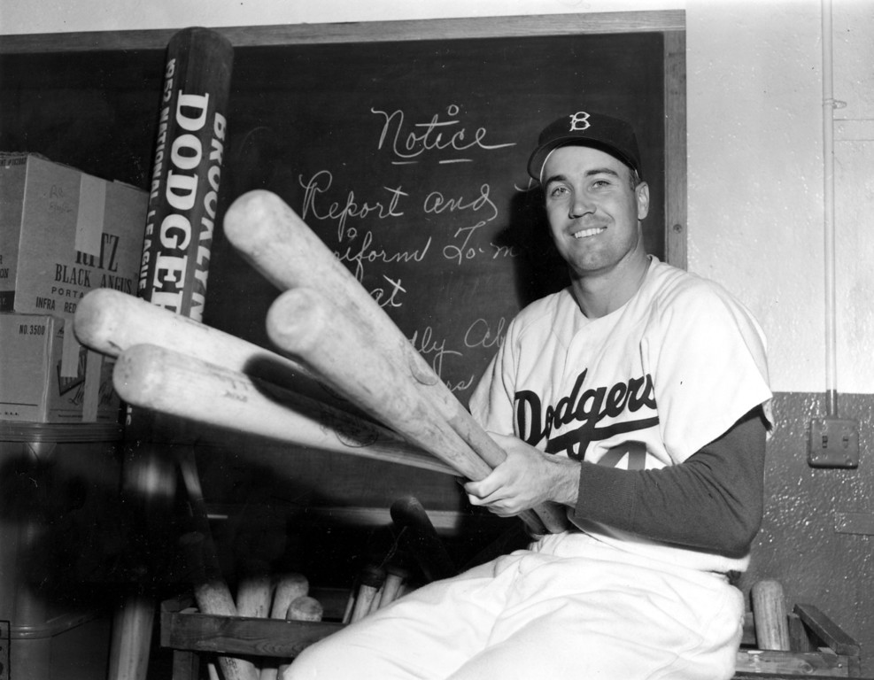. Brooklyn Dodgers center fielder Duke Snider smiles as he holds four bats, one for each homer hit in current World Series against the New York Yankees, in the clubhouse at Ebbets Field, Brooklyn, N.Y., after game six on Oct. 6, 1952.  Snider accounted for both Dodger runs with round trippers as Yankees won, 3-2.  Snider\'s two homers today enabled him to tie record set by Babe Ruth in 1926 and tied by Lou Gehrig in 1928.  (AP Photo)