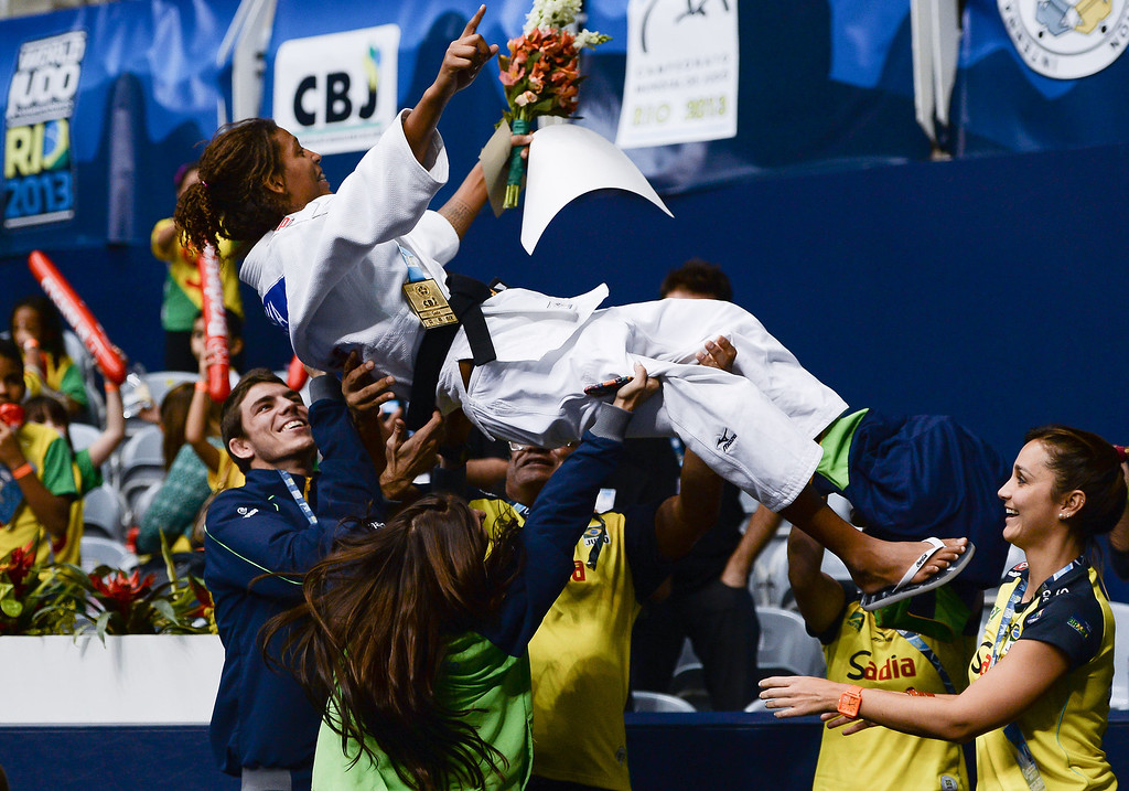 . RIO DE JANEIRO, BRAZIL - AUGUST 28: Gold medalist Brazil\'s Rafaela Silva is lifted up after the medal ceremony of the Women\'s 57kg category of the IJF World Judo Championship at Gymnasium Maracanazinho on August 28, 2013 in Rio de Janeiro, Brazil.(Photo by Buda Mendes/Getty Images)