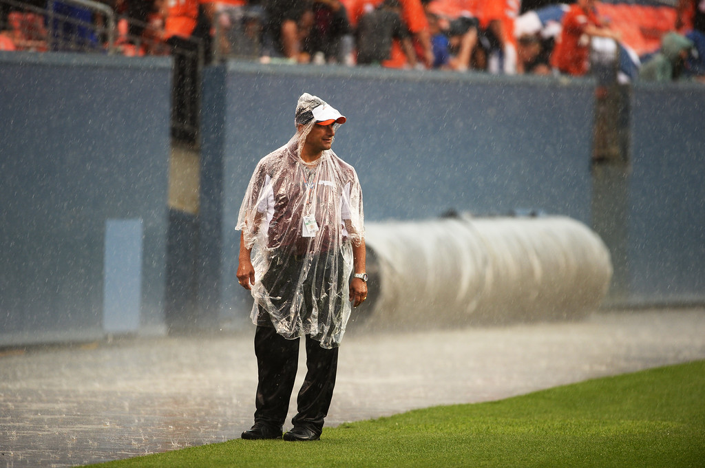 . DENVER, CO. - August 03: During storm, a security is in Sports Authority Field at Mile High. Denver, Colorado. August 03, 2013. (Photo By Hyoung Chang/The Denver Post)