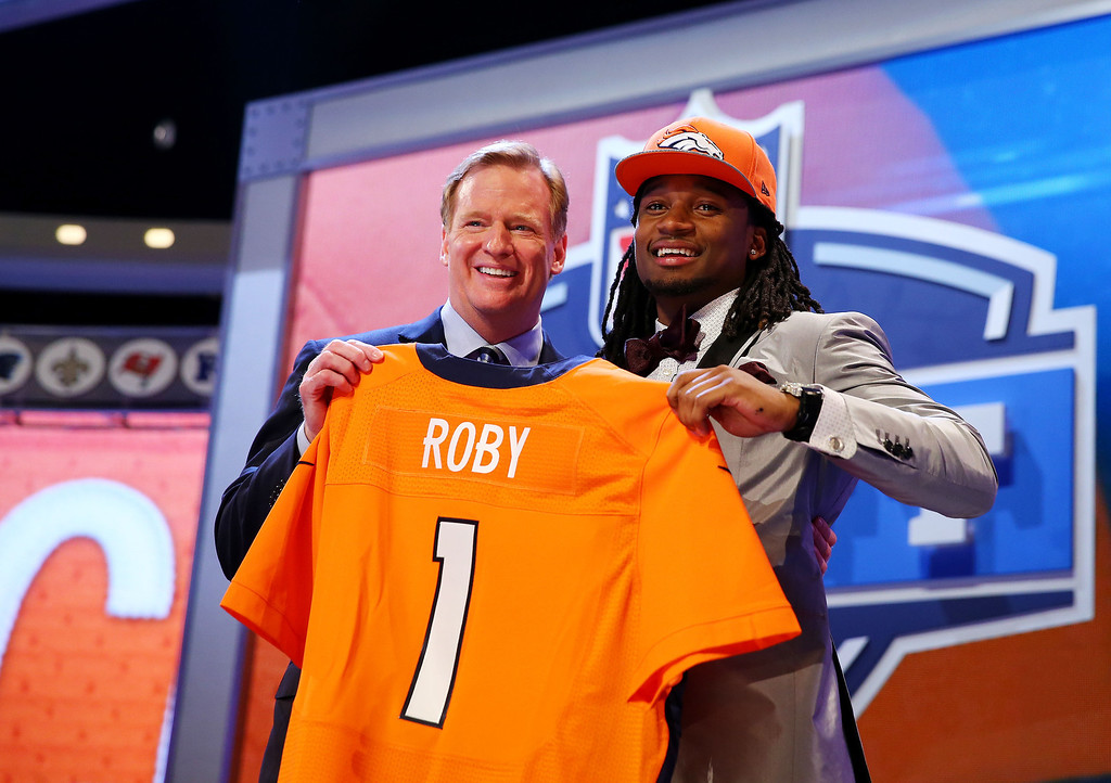 . Bradley Roby of the Ohio State Buckeyes poses with NFL Commissioner Roger Goodell after he was picked #31 overall by the Denver Broncos during the first round of the 2014 NFL Draft at Radio City Music Hall on May 8, 2014 in New York City.  (Photo by Elsa/Getty Images)