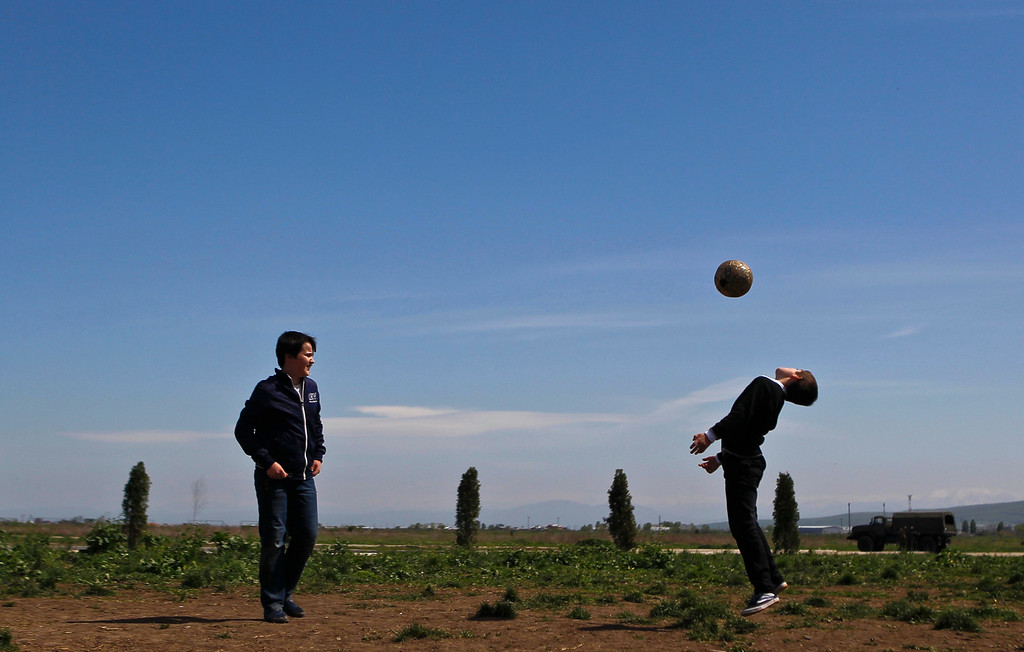 . Boys play soccer on the outskirts of the Chechen capital Grozny April 27, 2013. The naming of two Chechens, Dzhokhar and Tamerlan Tsarnaev, as suspects in the Boston Marathon bombings has put Chechnya - the former site of a bloody separatist insurgency - back on the world\'s front pages. Chechnya appears almost miraculously reborn. The streets have been rebuilt. Walls riddled with bullet holes are long gone. New high rise buildings soar into the sky. Spotless playgrounds are packed with children. A giant marble mosque glimmers in the night. Yet, scratch the surface and the miracle is less impressive than it seems. Behind closed doors, people speak of a warped and oppressive place, run by a Kremlin-imposed leader through fear.    Picture taken April 27, 2013.   REUTERS/Maxim Shemetov